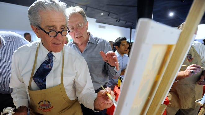 """Abilene mayoral candidate Robert Briley (left) gets advice from painting coach H.C. Zachry during the """"Celebrity Paint-Off"""" at the Center for Contemporary Arts on Thursday, April 27, 2017."""