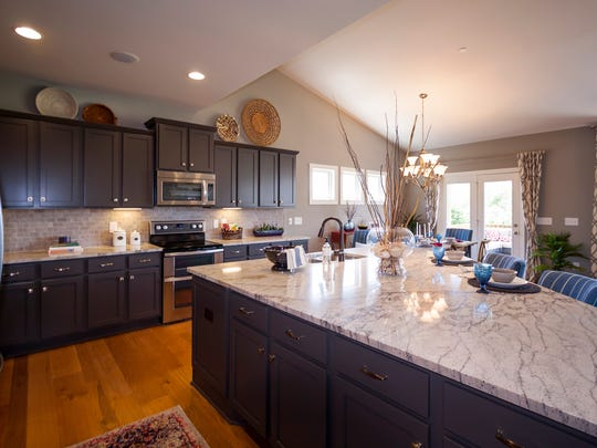 An open kitchen offers plenty of space for families to gather in this Jones Co. plan.