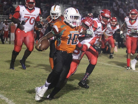 Immokalee's Terson Jean Baptiste tries to bring down