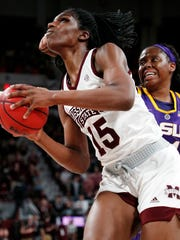 Mississippi State center Teaira McCowan (15) draws aim for a layup as she drives past LSU center Faustine Aifuwa, during the first half of an NCAA college basketball game in Starkville, Miss., Thursday, Feb. 28, 2019. (AP Photo/Rogelio V. Solis)