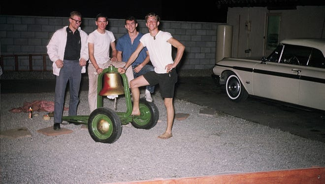 FILE - From left to right: Jim Feickert, Pat Bray, Ken Watts and Brad Davis. All four went to Indio High School and played on the football team. They stole the bell as a prank in 1962 and returned it to CV several weeks later.