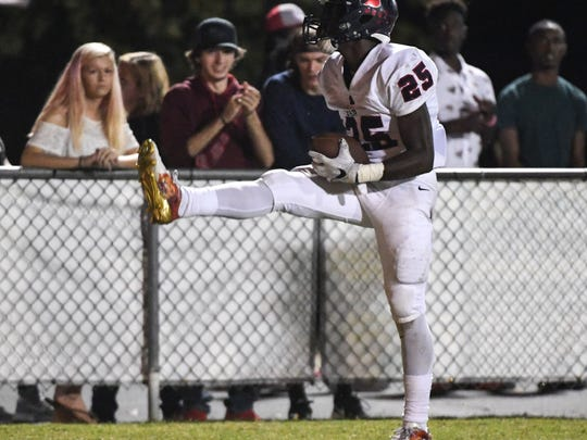 Belton-Honea PathÊrunning back R.J. Ellis reacts after getting a first down against Palmetto during the third quarter at Palmetto High School in Williamston on Friday.
