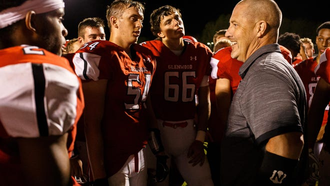 Glenwood football head coach David Hay congratulates his team after they defeated Springfield 49-20 at Glenwood High School, Friday, Sept. 13, 2019, in Chatham.