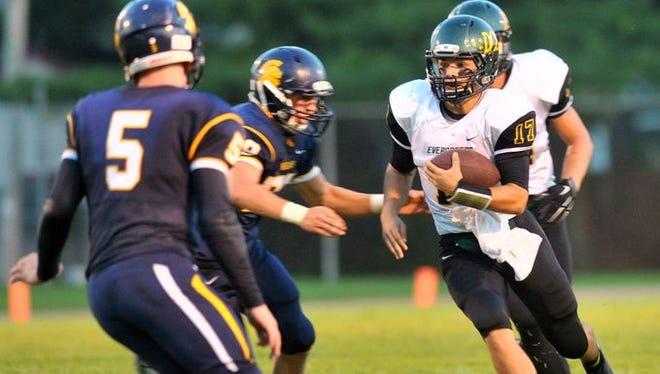 Everest quarterback Brady Uekert looks for running room in a win over Wausau West last week at Thom Field.