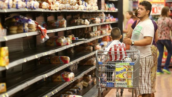 People shop for groceries in preparation for Hurricane Patricia in Puerto Vallarta, Mexico, on Oct. 23.