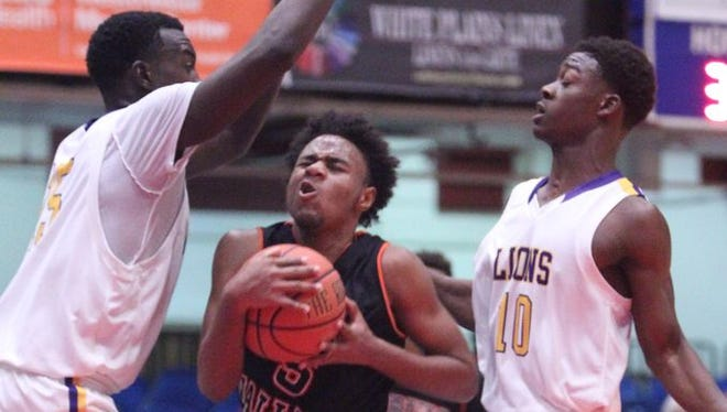 Bishop Loughlin beat Spring Valley 67-65 to win the Slam Dunk Tournament final at the Westchester County Center Dec. 29, 2015.