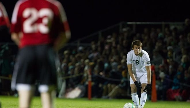 D.C. Everest's Jack Mittelsteadt prepares to take a  free kick against SPASH during a WIAA Division 1 sectional semifinal last month. Mittelsteadt was named the Wisconsin Valley Conference boys soccer player of the year for a second straight season.