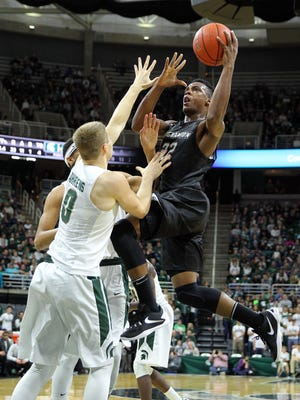 Binghamton University guard Everson Davis drives to the basket against Michigan State Spartans guard Kyle Ahrens (0) during the first half of a game on Dec 5, 2015, at the Jack Breslin Student Events Center in East Lansing, MI.