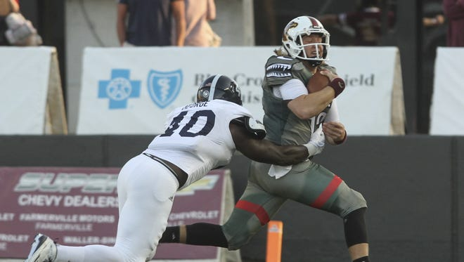 Quarterback Garrett Smith (13) is leading ULM in passing and rushing through two games.