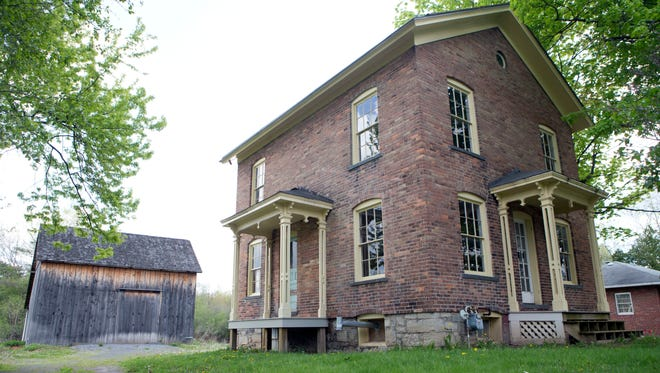 FILE- In this May 19, 2016, file photo, the Harriet Tubman Residence is seen at the Harriet Tubman Home in Auburn, N.Y. New York lawmakers and federal parks officials are gathering in Washington, to formally establish the Harriet Tubman National Historical Park in New York. U.S. Interior Secretary Sally Jewell will preside over an official signing ceremony Tuesday, Jan. 10, 2017, that will make the park part of the National Park System.
