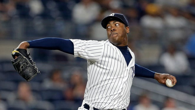 New York Yankees relief pitcher Aroldis Chapman delivers a pitch during the ninth inning of a baseball game against the Boston Red Sox on Sunday, July 17, 2016, in New York. The Yankees won 3-1.
