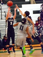 South Lyon East's McKenzie Mallory (3) launches a jump