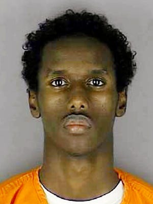 This undated file photo provided by the Hennepin County Sheriff's Office shows Guled Ali Omar. The Minnesota man accused of plotting to join the Islamic State group testified in his own defense in federal court on multiple counts, including conspiracy to commit murder outside the United States Thursday, May 26, 2016 in Minneapolis.