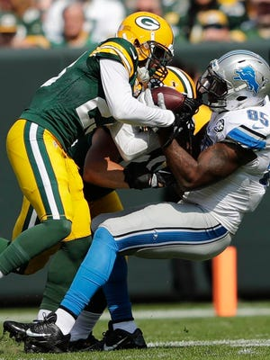 Green Bay Packers cornerback Damarious Randall takes a pass away from Detroit Lions tight end Eric Ebron in the second quarter.