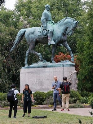 Robert E. Lee statue in park, Charlottesville, Va., Aug. 14, 2017.