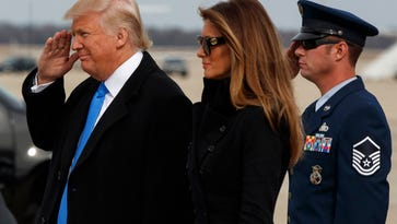 President-elect Donald Trump salutes as he and his wife, Melania, arrive at Andrews Air Force Base, Maryland, Thursday ahead of Friday's inauguration.
