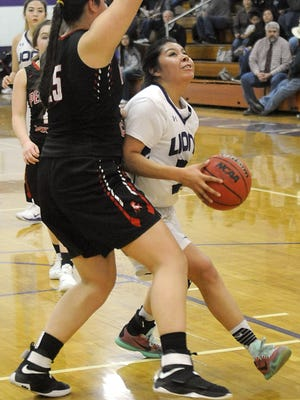 Juliah Brown goes up for a shot against heavy defense from Pershing County's Faith Norcutt-happy.