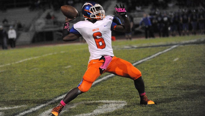 Millville's Bruce Williams throws for a touchdown against Hammonton Friday, Oct. 14, 2016 in Hammonton.