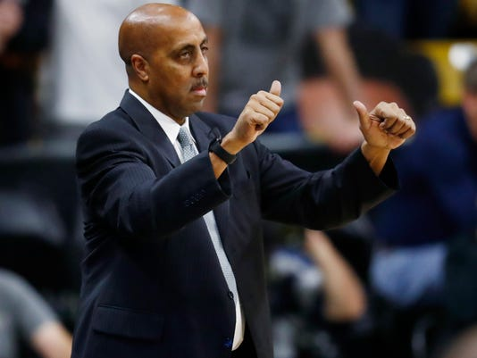 Washington head coach Lorenzo Romar signals to his players as they face Colorado in the first half of an NCAA college basketball game Thursday, Feb. 9, 2017, in Boulder, Colo. (AP Photo/David Zalubowski)