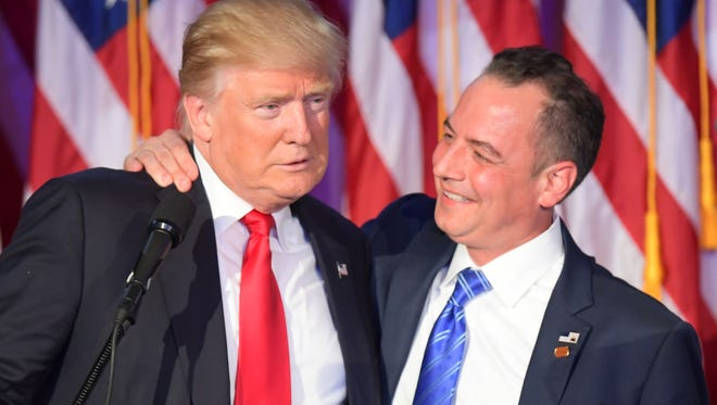Chairman of the Republican National Committee Reince Priebus (right) hugs Republican President-elect Donald Trump during election night at the New York Hilton Midtown in New York on Nov. 9.