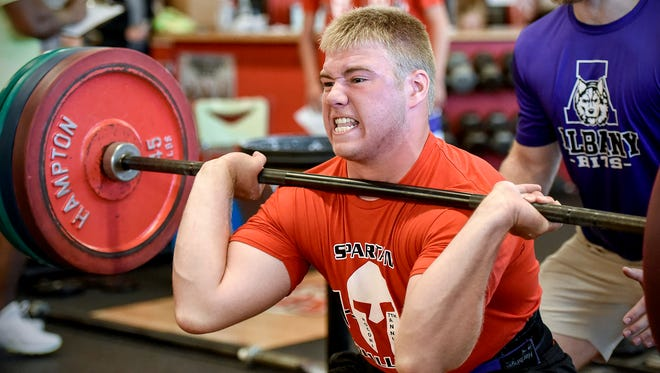 Carter Fish, Albany, pushes up 245 pounds during the Spartan Challenge Tuesday, July 31, at Rocori High School in Cold Spring. Area athletes competed in weight lifting, a 40-yard dash, vertical jump and agility events.