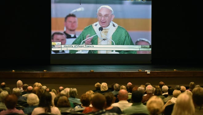 About 300 people filled the auditorium at Paul VI High School to watch Pope Francis conduct mass from Philadelphia's Benjamin Franklin Parkway.