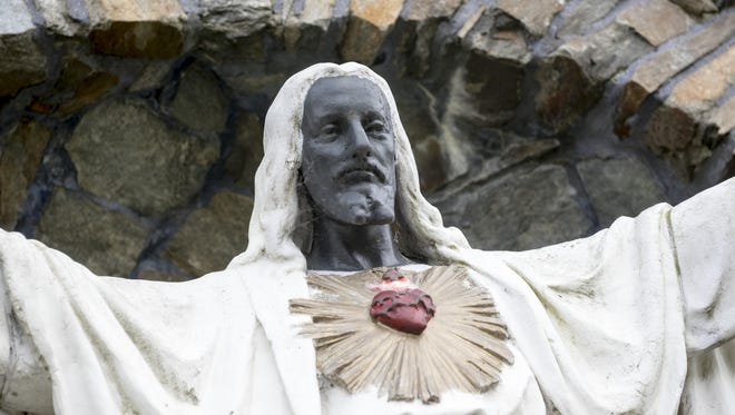 The Jesus statue at Sacred Heart Major Seminary went from white, to black or brown, to white, to black in 1967. The Sacred Heart rector said residents remain passionate about it.