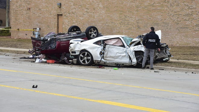 Vehicles are badly damaged following a crash at Dove and 24th streets in Port Huron Wednesday, April 11, 2018.