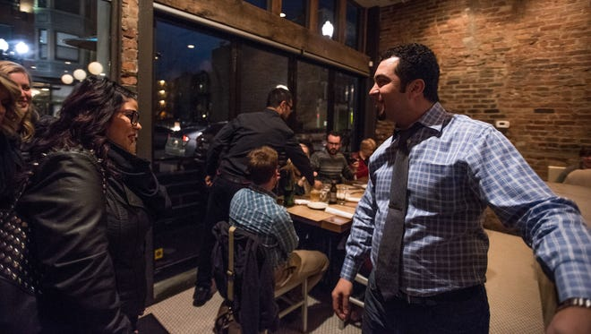 Senate general manager Ilyas Bourchid welcomes diners into the small restaurant on Vine Street in Over-the-Rhine.