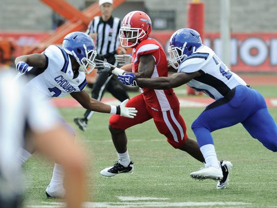 Delaware State University's #4 Malik Golson runs with the ball in their 30-31 loss against Chowan College.