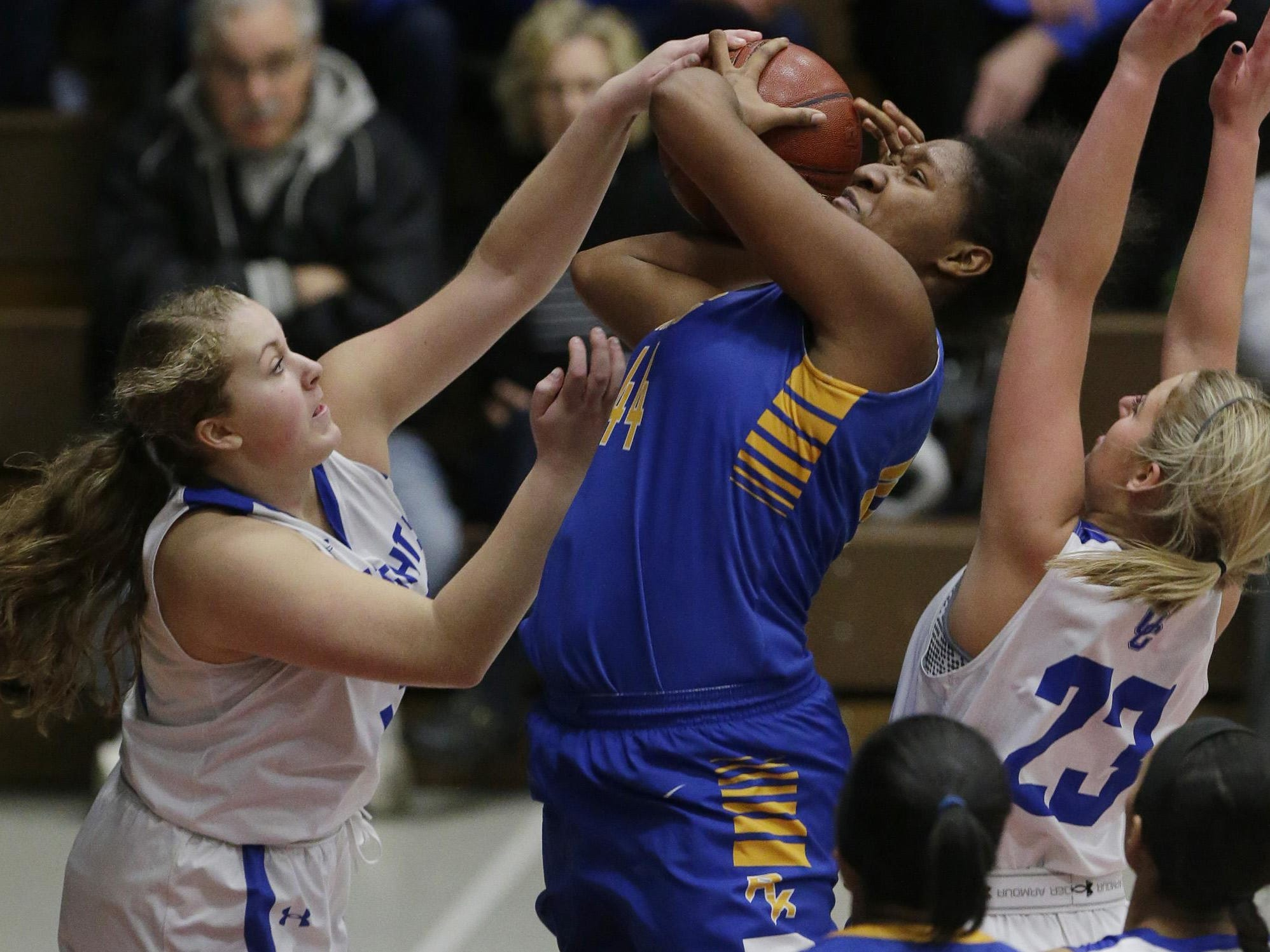 Milwaukee King's Sydnee Roby, a 6-foot-4 sophomore, puts up a shot against Oak Creek during a sectional championship game Saturday.