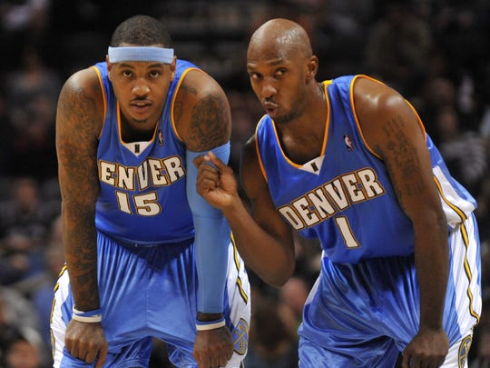 ORG XMIT: NY156 FILE - This Dec. 5, 2009, file photo shows Denver Nuggets players Carmelo Anthony (15) and Chauncey Billups during a teammate's free throw attempt in the second half of an NBA basketball gameagainst the San Antonio Spurs,  in San Antonio. The Nuggets are saddened that All-Star Carmelo Anthony's trade demands meant they had to say goodbye to hometown favorite Chauncey Billups, too. (AP Photo/ Bahram Mark Sobhani, File)