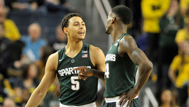 Michigan State guards Bryn Forbes and Eron Harris.
