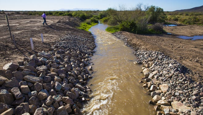 Water is diverted from a spreader station in one of three different directions toward the Gila River in Sacaton.