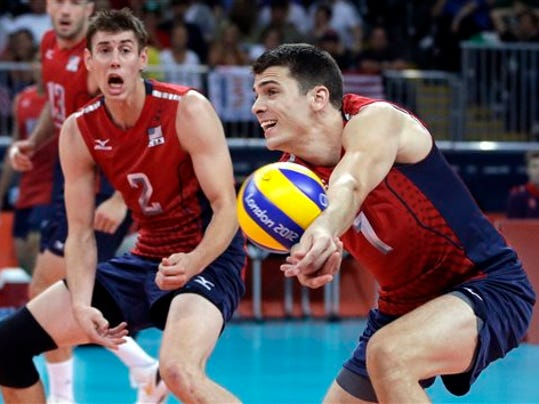 Penn State grad Matt Anderson, right, controls the ball during the United States' men's volleyball match against Russia during the London Games. (Associated Press)
