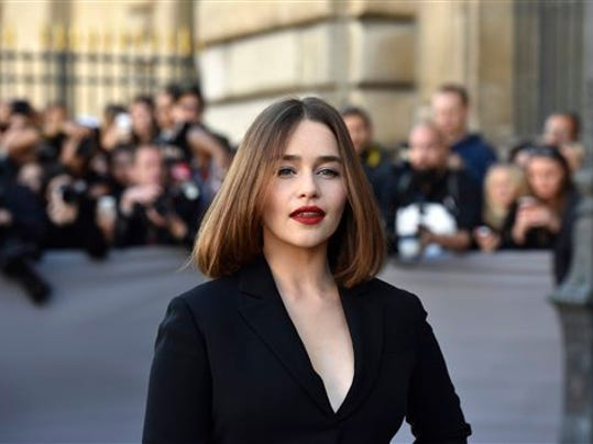 British actress Emilia Clarke poses for photogrpahers before Christian Dior's Spring-Summer 2016 ready-to-wear fashion collection presented during the Paris Fashion Week, in Paris, France, Friday, Oct. 2, 2015. (AP Photo/Zacharie Scheurer)