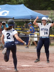 Pine Plains' Catherine Simmons celebrates an early run during thier loss to Bishop Kearney on Saturday in South Glens Falls.