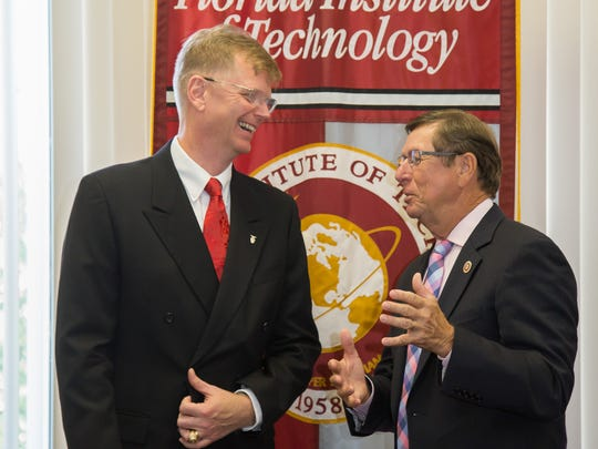 AFTAC chief scientist (left) Dr. Glenn Sjoden. Florida Tech President and CEO (right) Dr. Dwayne McCay.