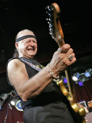 "In this May 27, 2007, file photo, Dick Dale, known as ""The King of the Surf Guitar,"" performs at B.B. King Blues Club in New York."