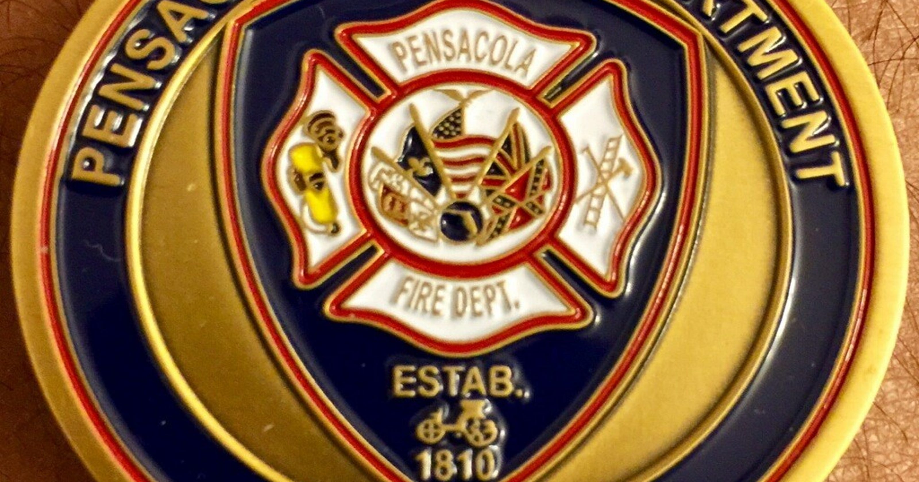 Coin causes controversy at Pensacola Fire Department