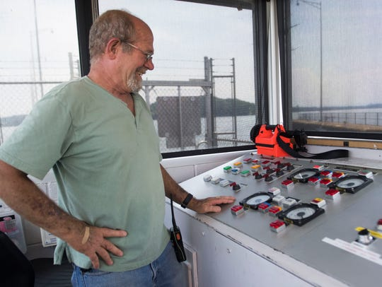 Senior lock operator Paul Murry stands over the controls