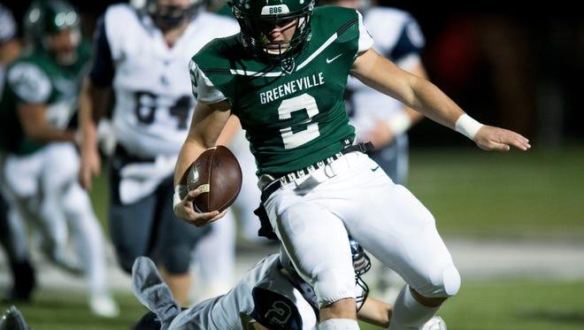 Greeneville quarterback Cade Ballard runs for yards against Anderson County on Nov. 17, 2017.