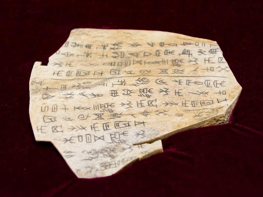 """An oracle bone replica called """"The King"""" on simulated ox shoulder bone at a preview of the Chinese Festival at the Chinese American Community Center in Hockessin on Thursday."""