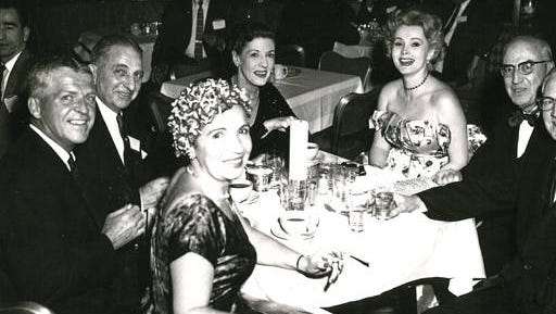 Zsa Zsa Gabor, who recently died at age 99, was among those grinning for the camera at a Westinghouse soiree in Mansfield, probably in 1958.  Westinghouse promotion manager Gil Baird is seated at her left, and another executive, Bob Lynch, is on the far left. Please email me if you can identify the rest and can confirm the place and occasion. (Zsa Zsa Gabor, who recently died at age 99, was among those grinning for the camera at a Westinghouse soiree in Mansfield, probably in 1958.  Westinghouse promotion manager Gil Baird is seated at her left, and another executive, Bob Lynch, is on the far left. Please email me if you can identify the rest and can confirm the place and occasion. (photo courtesy of the Mansfield-Richland County Public Library)