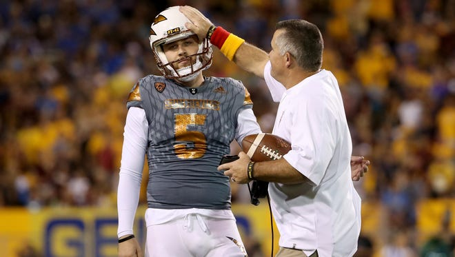 After kicking a 46-yard field goal against UCLA in 2016, Zane Gonzalez is congratulated by head coach Todd Graham for breaking the all-time FBS record for most field goals.