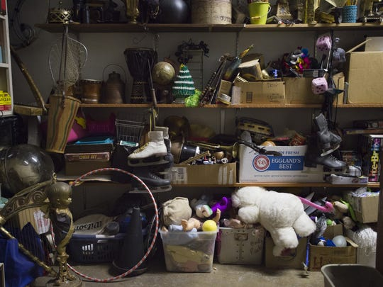 Props line the walls of a shared warehouse and storage space used by local arts organizations like OpenStage Theatre and Canyon Concert Ballet Friday, December 9, 2016.
