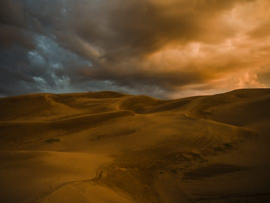 The sun begins to rise over the Great Sand Dunes National