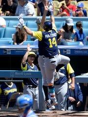 Milwaukee Brewers left fielder Hernan Perez (14) celebrates