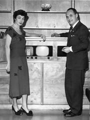 This 1950 image shows Governor Walter Kohler Jr. and Mrs. Charlotte Kohler in their home, Windway, showcasing a new television.