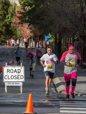 Runners during the Susan G. Komen Race for the Cure held on Sunday, October16, 2016 in downtown Reno.
